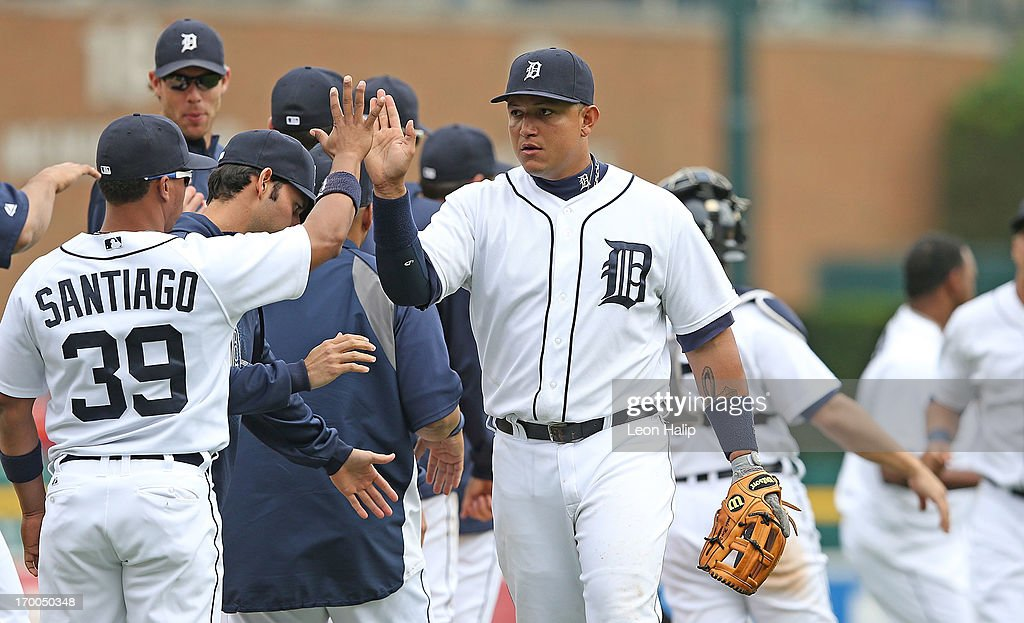 <a gi-track='captionPersonalityLinkClicked' href=/galleries/search?phrase=Miguel+Cabrera&family=editorial&specificpeople=202141 ng-click='$event.stopPropagation()'>Miguel Cabrera</a> #24 of the Detroit Tigers celebrates a win over the Tampa Bay Rays with teammate <a gi-track='captionPersonalityLinkClicked' href=/galleries/search?phrase=Ramon+Santiago&family=editorial&specificpeople=2984417 ng-click='$event.stopPropagation()'>Ramon Santiago</a> #39 at Comerica Park on June 6, 2013 in Detroit, Michigan. The Tigers defeated the Rays 5-2.