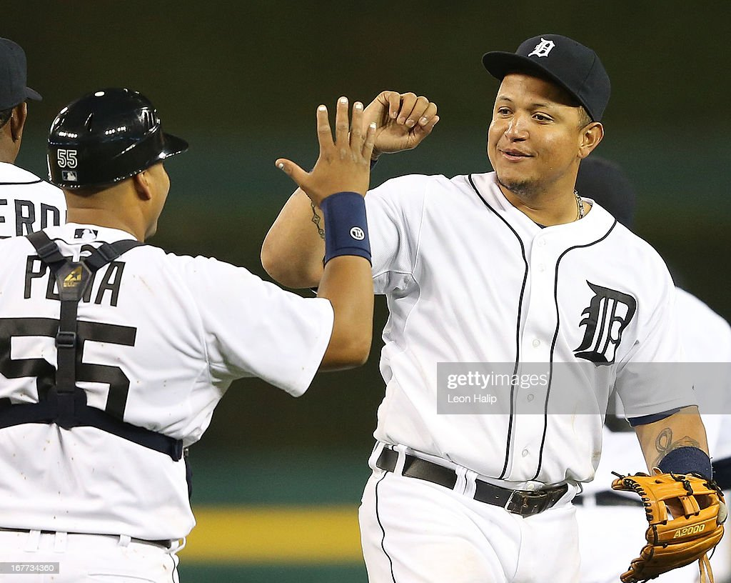 Miguel Cabrera #24 of the Detroit Tigers celebrates a win over the Atlanta Braves with teammate Brayan Pena #55 after at Comerica Park on April 28, 2013 in Detroit, Michigan. The Tigers defeated the Braves 8-3.