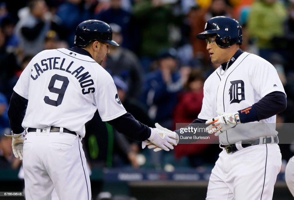 Miguel Cabrera #24 of the Detroit Tigers celebrates his two-run home run against the Cleveland Indians with Nicholas Castellanos #9 of the Detroit Tigers during the third inning at Comerica Park on May 2, 2017 in Detroit, Michigan.