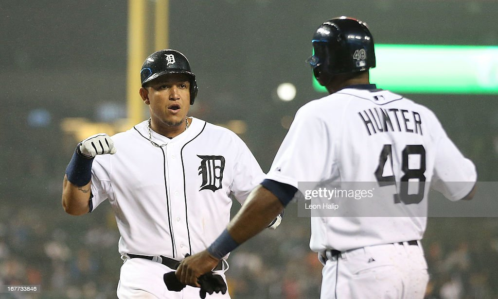 <a gi-track='captionPersonalityLinkClicked' href=/galleries/search?phrase=Miguel+Cabrera&family=editorial&specificpeople=202141 ng-click='$event.stopPropagation()'>Miguel Cabrera</a> #24 of the Detroit Tigers celebrates hitting a three-run home run in the seventh inning scoring Austin Jackson #14 and <a gi-track='captionPersonalityLinkClicked' href=/galleries/search?phrase=Torii+Hunter&family=editorial&specificpeople=183408 ng-click='$event.stopPropagation()'>Torii Hunter</a> #48 during the game against the Atlanta Braves at Comerica Park on April 28, 2013 in Detroit, Michigan.