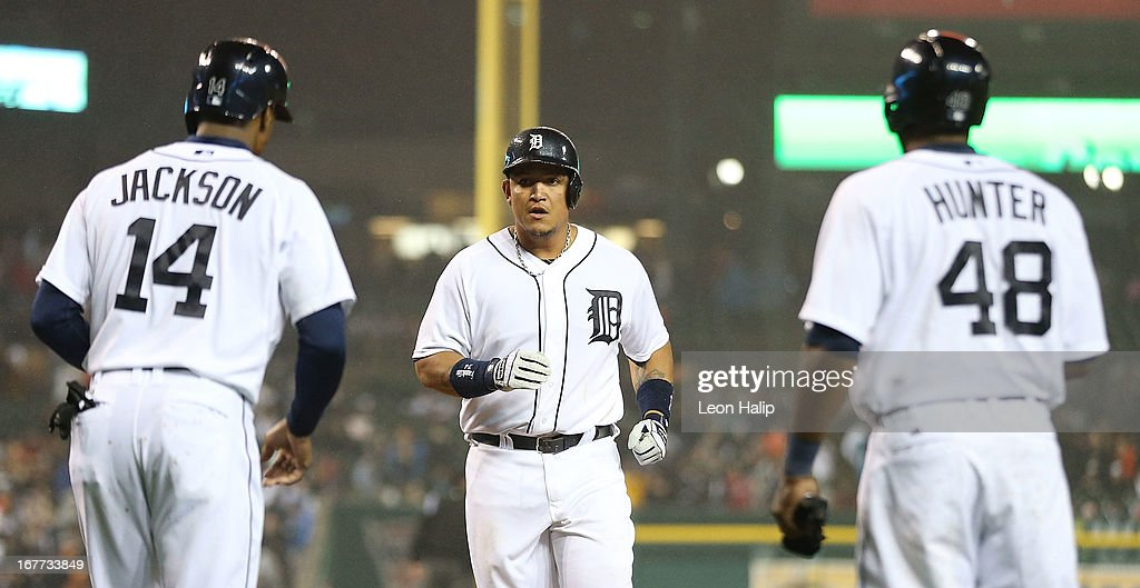 Miguel Cabrera #24 of the Detroit Tigers celebrates hitting a three-run home run in the seventh inning scoring Austin Jackson #14 and Torii Hunter #48 during the game against the Atlanta Braves at Comerica Park on April 28, 2013 in Detroit, Michigan.