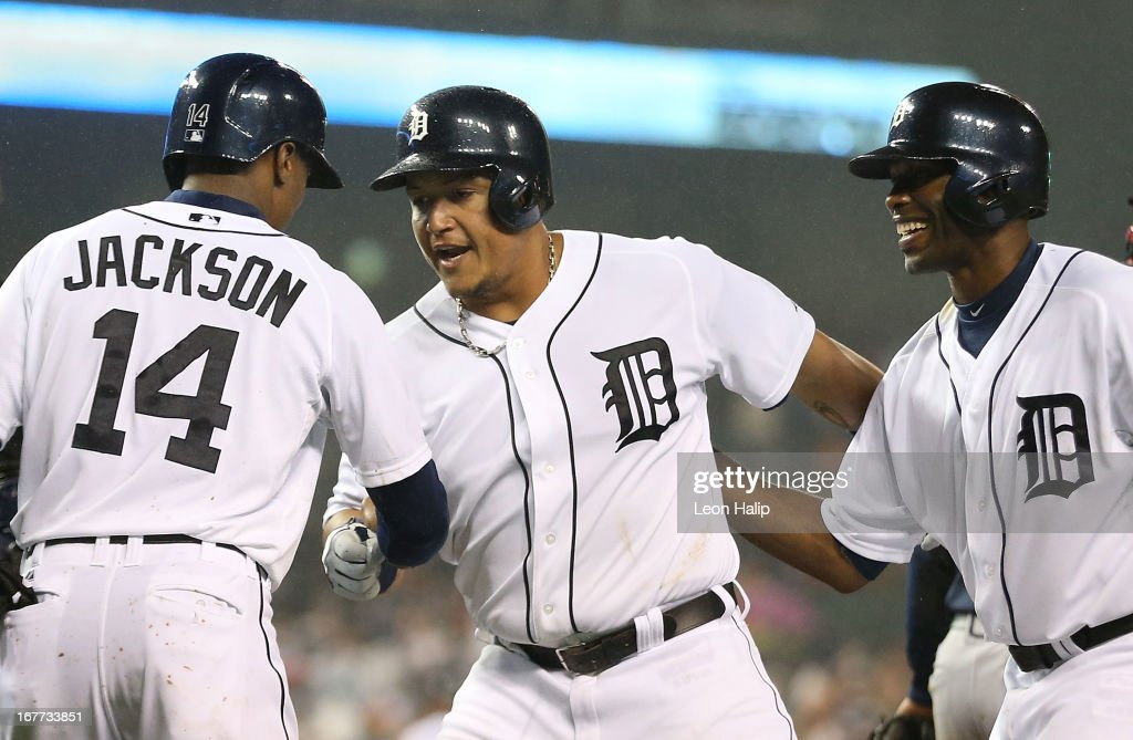 <a gi-track='captionPersonalityLinkClicked' href=/galleries/search?phrase=Miguel+Cabrera&family=editorial&specificpeople=202141 ng-click='$event.stopPropagation()'>Miguel Cabrera</a> #24 of the Detroit Tigers celebrates hitting a three-run home run in the seventh inning scoring <a gi-track='captionPersonalityLinkClicked' href=/galleries/search?phrase=Austin+Jackson&family=editorial&specificpeople=608633 ng-click='$event.stopPropagation()'>Austin Jackson</a> #14 and <a gi-track='captionPersonalityLinkClicked' href=/galleries/search?phrase=Torii+Hunter&family=editorial&specificpeople=183408 ng-click='$event.stopPropagation()'>Torii Hunter</a> #48 during the game against the Atlanta Braves at Comerica Park on April 28, 2013 in Detroit, Michigan.