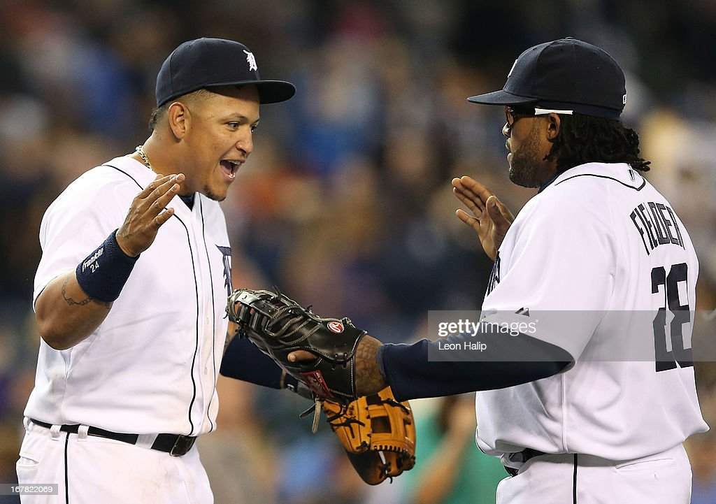 <a gi-track='captionPersonalityLinkClicked' href=/galleries/search?phrase=Miguel+Cabrera&family=editorial&specificpeople=202141 ng-click='$event.stopPropagation()'>Miguel Cabrera</a> #24 of the Detroit Tigers celebrates with his teammate <a gi-track='captionPersonalityLinkClicked' href=/galleries/search?phrase=Prince+Fielder&family=editorial&specificpeople=209392 ng-click='$event.stopPropagation()'>Prince Fielder</a> #28 after beating the Minnesota Twins at Comerica Park on April 30, 2013 in Detroit, Michigan. The Tigers defeated the Twins 6-1.