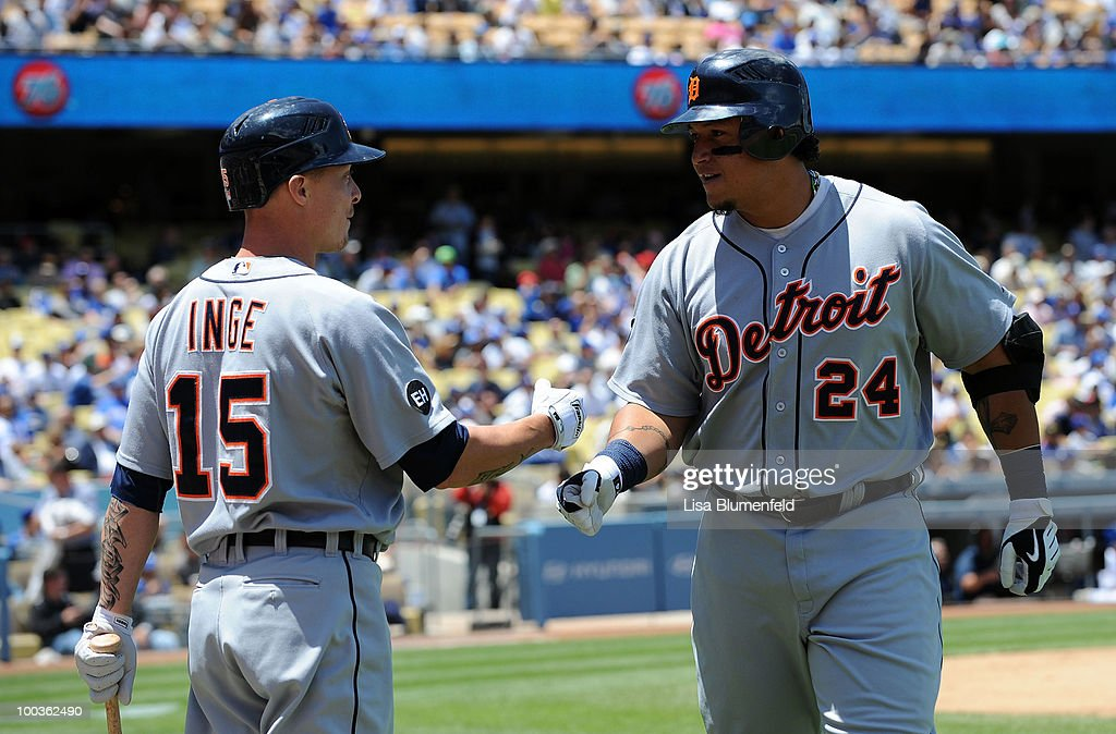 Miguel Cabrera #24 of the Detroit Tigers celebrates with teammate Brandon Inge #15 after hitting a two run homerun in the first inning against the Los Angeles Dodgers at Dodger Stadium on May 23, 2010 in Los Angeles, California.