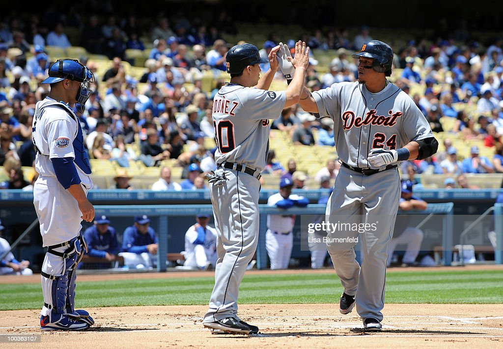 Miguel Cabrera #24 of the Detroit Tigers celebrates with teammate Magglio Ordonez #30 after hitting a two run homerun in the first inning against the Los Angeles Dodgers at Dodger Stadium on May 23, 2010 in Los Angeles, California.