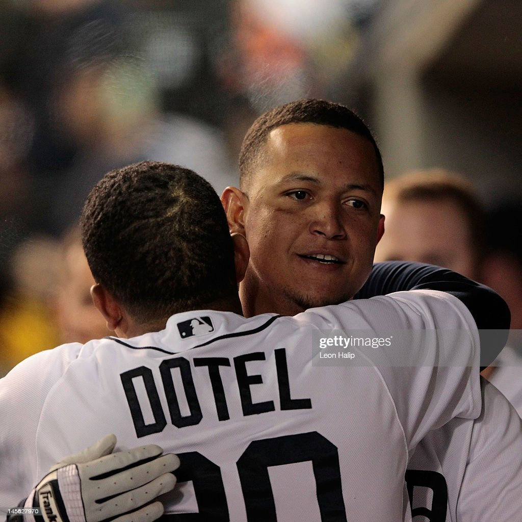 <a gi-track='captionPersonalityLinkClicked' href=/galleries/search?phrase=Miguel+Cabrera&family=editorial&specificpeople=202141 ng-click='$event.stopPropagation()'>Miguel Cabrera</a> #24 of the Detroit Tigers celebrates with teammate <a gi-track='captionPersonalityLinkClicked' href=/galleries/search?phrase=Octavio+Dotel&family=editorial&specificpeople=169829 ng-click='$event.stopPropagation()'>Octavio Dotel</a> #20 after hitting a solo home run to center field in the eighth inning during the game against the New York Yankees at Comerica Park on June 2, 2012 in Detroit, Michigan. The Tigers defeated the Yankees 4-3.