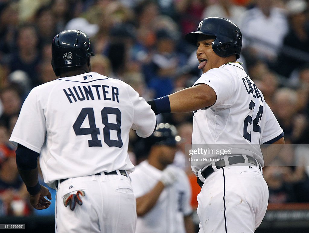 <a gi-track='captionPersonalityLinkClicked' href=/galleries/search?phrase=Miguel+Cabrera&family=editorial&specificpeople=202141 ng-click='$event.stopPropagation()'>Miguel Cabrera</a> #24 of the Detroit Tigers celebrates with <a gi-track='captionPersonalityLinkClicked' href=/galleries/search?phrase=Torii+Hunter&family=editorial&specificpeople=183408 ng-click='$event.stopPropagation()'>Torii Hunter</a> #48 after scoring against the Philadelphia Philles in the second inning on a single by Victor Martinez #41at Comerica Park on July 27, 2013 in Detroit, Michigan.