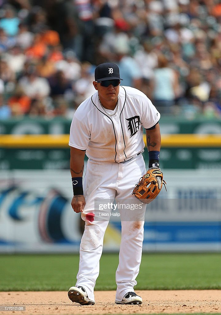 <a gi-track='captionPersonalityLinkClicked' href=/galleries/search?phrase=Miguel+Cabrera&family=editorial&specificpeople=202141 ng-click='$event.stopPropagation()'>Miguel Cabrera</a> #24 of the Detroit Tigers checks out his right leg after diving for a ball in the sixth inning of the game against the Minnesota Twins at Comerica Park on August 22, 2013 in Detroit, Michigan.