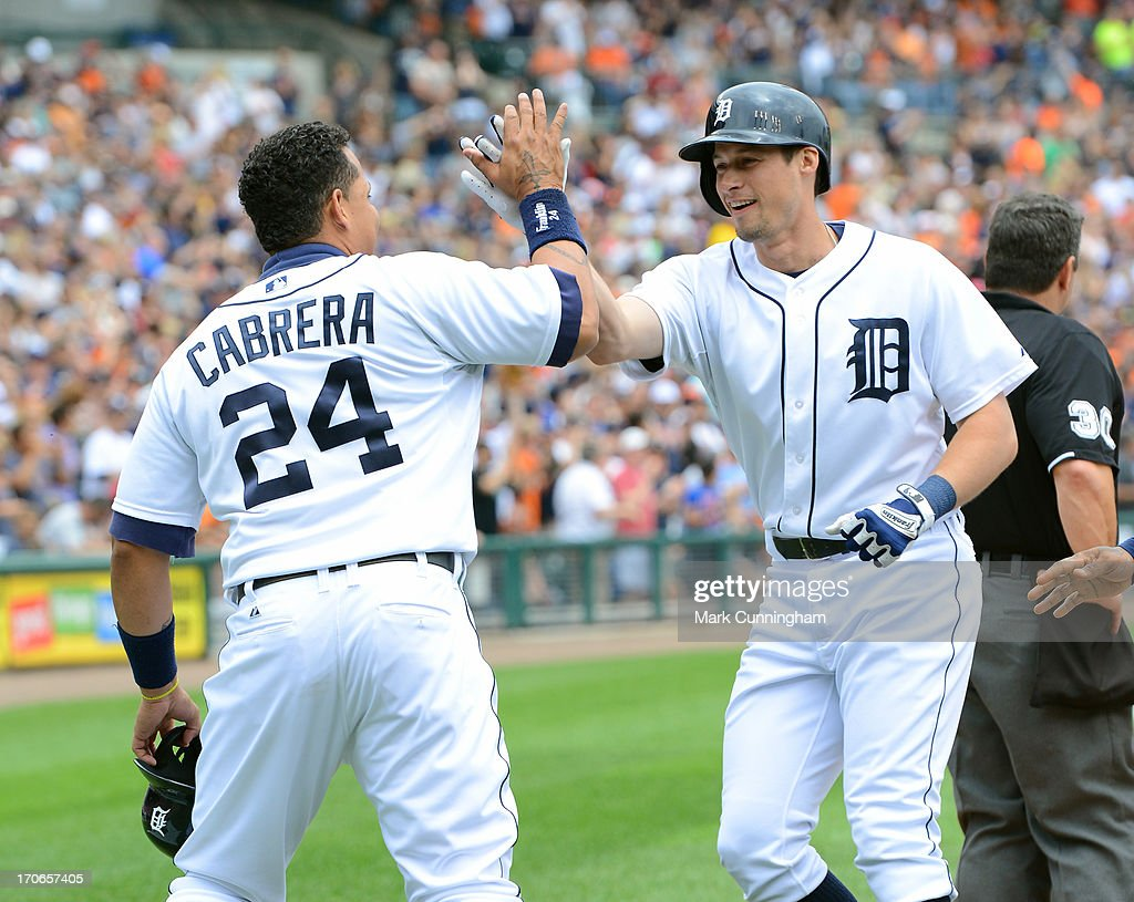 Miguel Cabrera #24 of the Detroit Tigers congratulates Don Kelly #32 after Kelly hit a 3-run home run during the game against the Cleveland Indians at Comerica Park on June 9, 2013 in Detroit, Michigan. The Tigers defeated the Indians 4-1.
