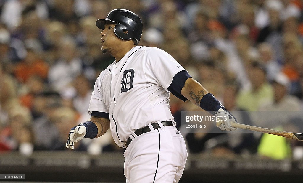 Miguel Cabrera #24 of the Detroit Tigers doubles to deep left center field scoring Austin Jackson #14 and Delmon Young #21 in the fourth inning of the game against the Chicago White Sox at Comerica Park on September 4, 2011 in Detroit, Michigan.