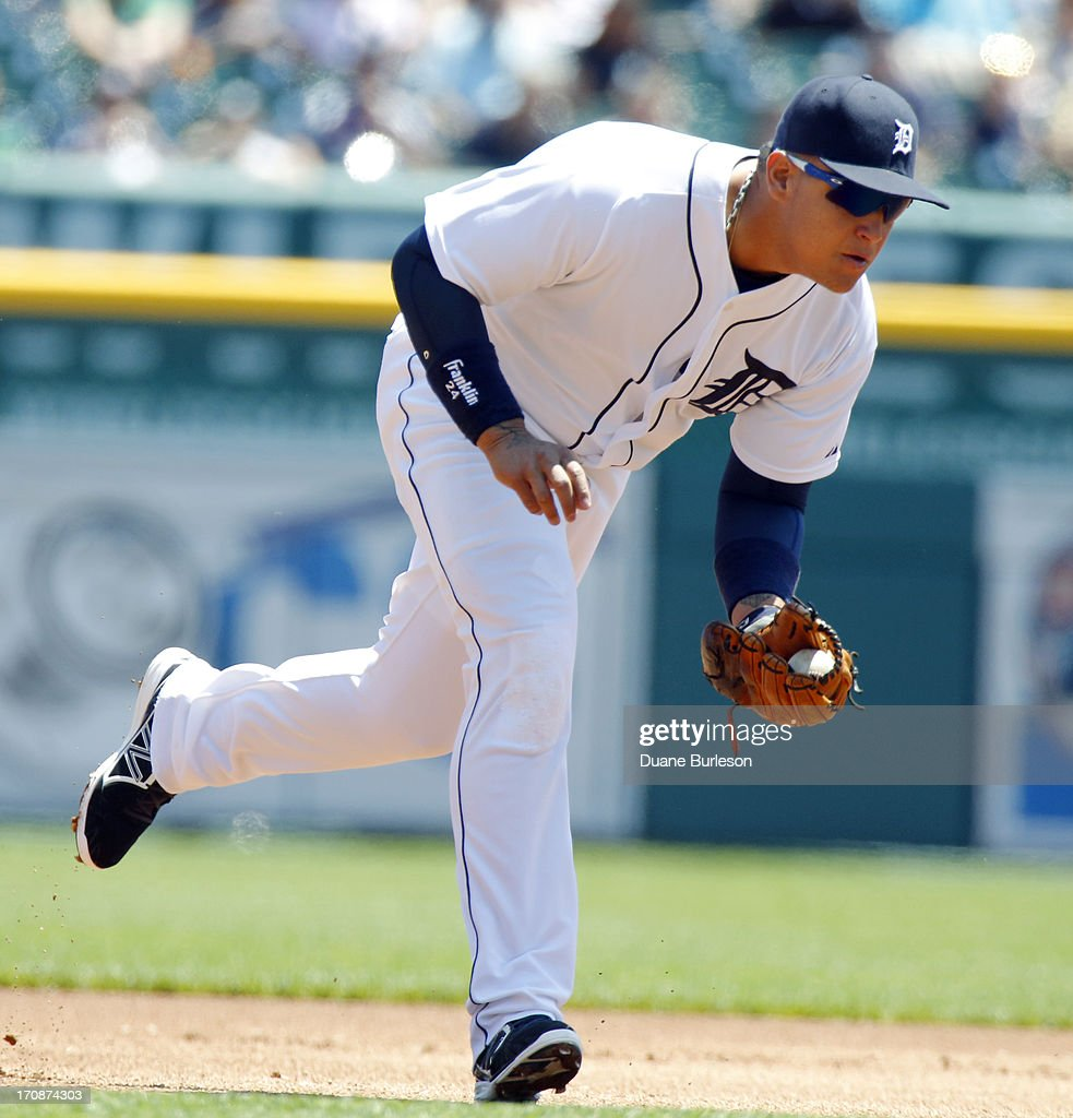 <a gi-track='captionPersonalityLinkClicked' href=/galleries/search?phrase=Miguel+Cabrera&family=editorial&specificpeople=202141 ng-click='$event.stopPropagation()'>Miguel Cabrera</a> #24 of the Detroit Tigers fields a grounder hit by Nick Markakis of the Baltimore Orioles for an out in the first inning at Comerica Park on June 19, 2013 in Detroit, Michigan.