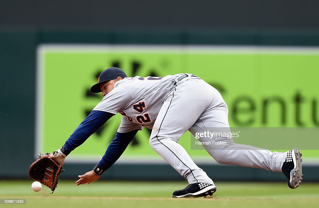 <a gi-track='captionPersonalityLinkClicked' href=/galleries/search?phrase=Miguel+Cabrera&family=editorial&specificpeople=202141 ng-click='$event.stopPropagation()'>Miguel Cabrera</a> #24 of the Detroit Tigers fields an infield single by Eduardo Escobar #5 of the Minnesota Twins during the fourth inning of the game on April 30, 2016 at Target Field in Minneapolis, Minnesota. The Tigers defeated the Twins 4-1.