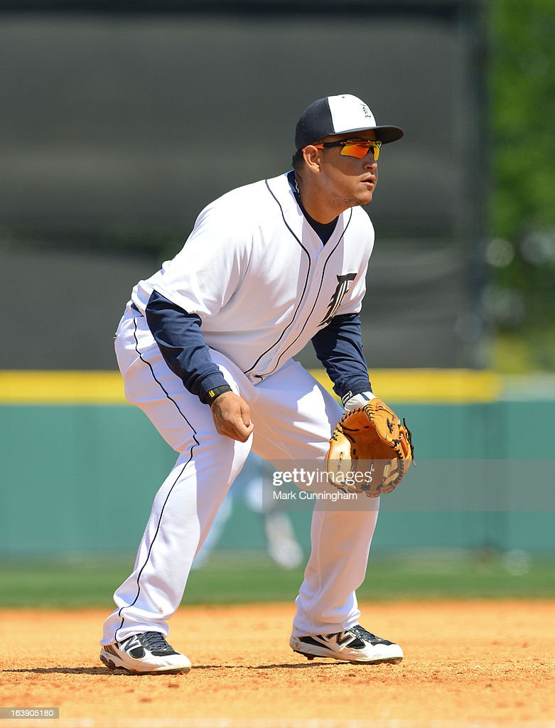 <a gi-track='captionPersonalityLinkClicked' href=/galleries/search?phrase=Miguel+Cabrera&family=editorial&specificpeople=202141 ng-click='$event.stopPropagation()'>Miguel Cabrera</a> #24 of the Detroit Tigers fields during the spring training game against the Toronto Blue Jays at Joker Marchant Stadium on March 15, 2013 in Lakeland, Florida. The Tigers defeated the Blue Jays 4-2.
