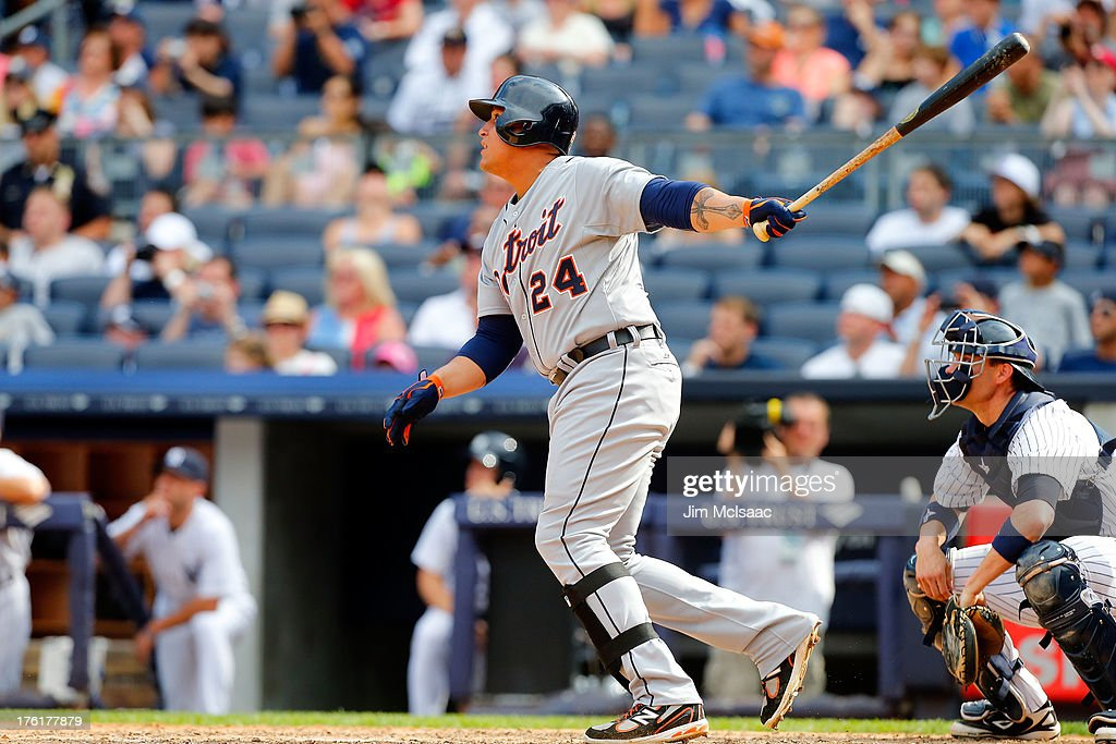 <a gi-track='captionPersonalityLinkClicked' href=/galleries/search?phrase=Miguel+Cabrera&family=editorial&specificpeople=202141 ng-click='$event.stopPropagation()'>Miguel Cabrera</a> #24 of the Detroit Tigers follows through on a ninth inning home run against the New York Yankees at Yankee Stadium on August 11, 2013 in the Bronx borough of New York City.