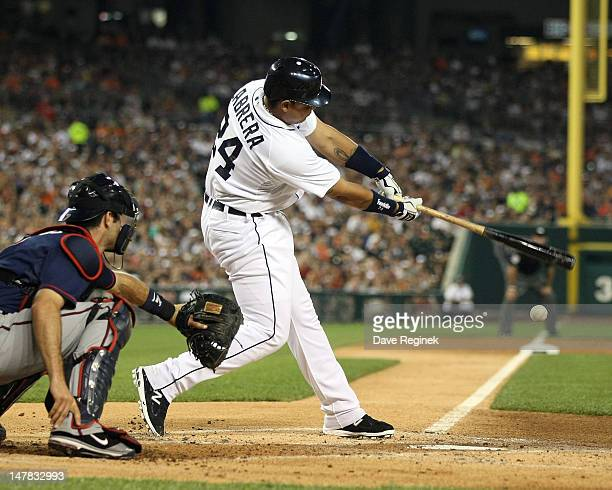 Miguel Cabrera of the Detroit Tigers hits a double down the third base line in the first inning during a MLB game against the Minnesota Twins at...