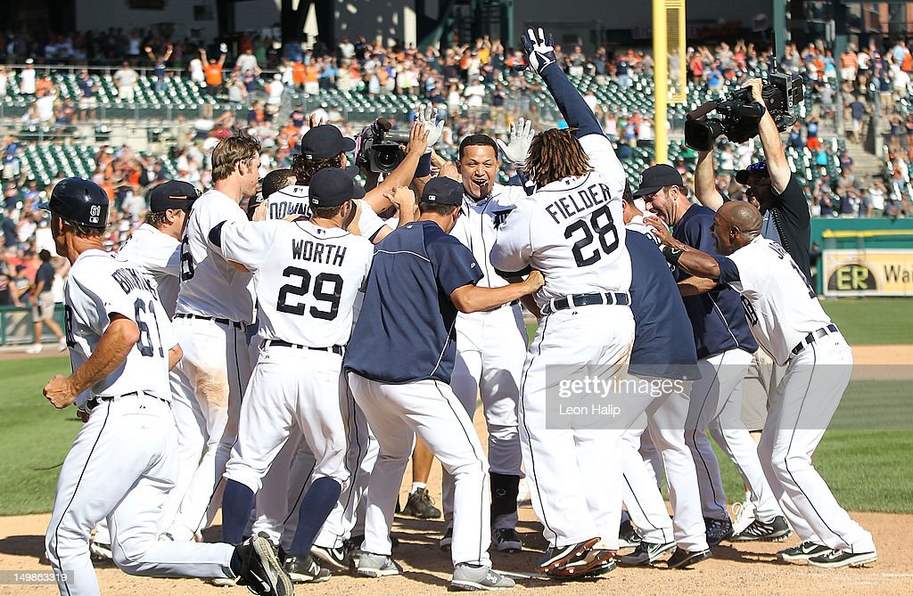 <a gi-track='captionPersonalityLinkClicked' href=/galleries/search?phrase=Miguel+Cabrera&family=editorial&specificpeople=202141 ng-click='$event.stopPropagation()'>Miguel Cabrera</a> #24 of the Detroit Tigers hits a game winning two run home run in the tenth inning scoring <a gi-track='captionPersonalityLinkClicked' href=/galleries/search?phrase=Omar+Infante&family=editorial&specificpeople=203255 ng-click='$event.stopPropagation()'>Omar Infante</a> #4 to give the Tigers a 10-8 win over the Cleveland Indians at Comerica Park on August 5, 2012 in Detroit, Michigan. The Tigers defeated the Indians 10-8.