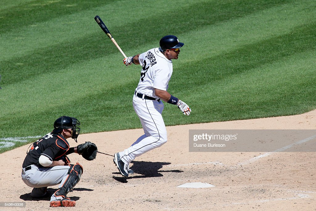 <a gi-track='captionPersonalityLinkClicked' href=/galleries/search?phrase=Miguel+Cabrera&family=editorial&specificpeople=202141 ng-click='$event.stopPropagation()'>Miguel Cabrera</a> #24 of the Detroit Tigers hits a single in front of catcher Jeff Mathis #6 of the Miami Marlins to drive in Cameron Maybin during the eighth inning at Comerica Park on June 29, 2016 in Detroit, Michigan. The Tigers defeated the Marlins 10-3.