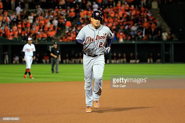 Miguel Cabrera of the Detroit Tigers hits a solo home run in the eighth inning against Darren O'Day of the Baltimore Orioles during Game One of the...