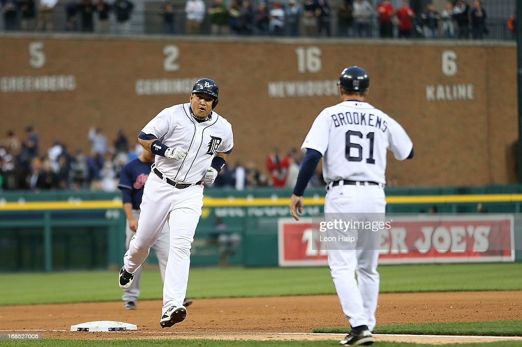 <a gi-track='captionPersonalityLinkClicked' href=/galleries/search?phrase=Miguel+Cabrera&family=editorial&specificpeople=202141 ng-click='$event.stopPropagation()'>Miguel Cabrera</a> #24 of the Detroit Tigers hits a three run home run in the fourth inning scoring <a gi-track='captionPersonalityLinkClicked' href=/galleries/search?phrase=Omar+Infante&family=editorial&specificpeople=203255 ng-click='$event.stopPropagation()'>Omar Infante</a> #4 and <a gi-track='captionPersonalityLinkClicked' href=/galleries/search?phrase=Austin+Jackson&family=editorial&specificpeople=608633 ng-click='$event.stopPropagation()'>Austin Jackson</a> #14 during the game against the Cleveland Indians at Comerica Park on May 10, 2013 in Detroit, Michigan.