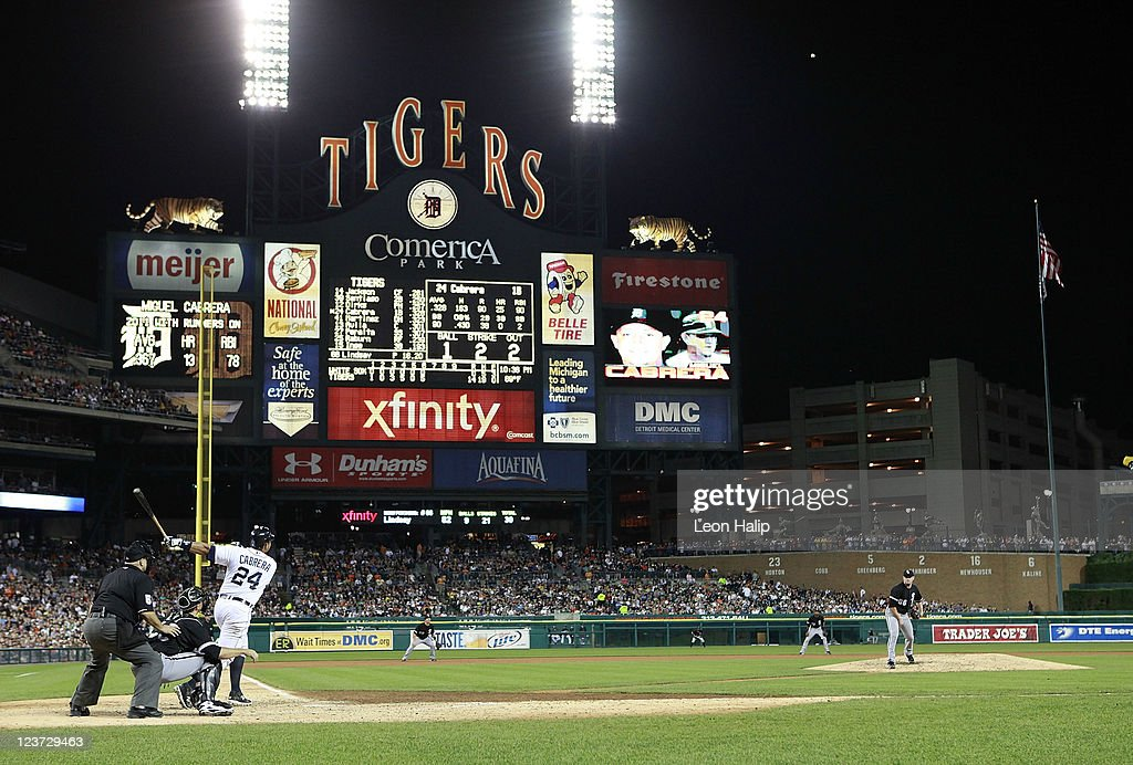 Miguel Cabrera #24 of the Detroit Tigers hits a two-run home run to centerfield in the sixth inning scoring Andy Dirks #12 during the game against the Chicago White Sox at Comerica Park on September 4, 2011 in Detroit, Michigan.