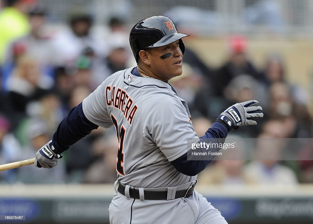 Miguel Cabrera #24 of the Detroit Tigers hits an RBI single against the Minnesota Twins during the fifth inning of the game on April 3, 2013 at Target Field in Minneapolis, Minnesota.