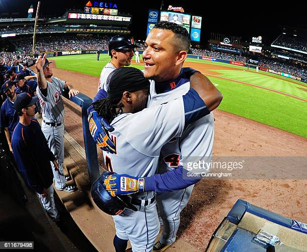 Miguel Cabrera of the Detroit Tigers is congratulated by Cameron Maybin after hitting a third inning solo home run against the Atlanta Braves at...