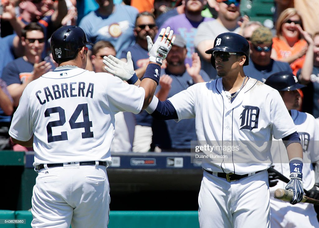 Miguel Cabrera #24 of the Detroit Tigers is congratulated by Victor Martinez #41 of the Detroit Tigers after hitting a solo home run against the Miami Marlins during the fourth inning at Comerica Park on June 29, 2016 in Detroit, Michigan.