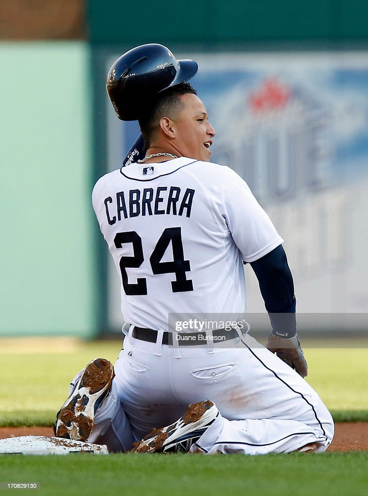 <a gi-track='captionPersonalityLinkClicked' href=/galleries/search?phrase=Miguel+Cabrera&family=editorial&specificpeople=202141 ng-click='$event.stopPropagation()'>Miguel Cabrera</a> #24 of the Detroit Tigers kneels at second base after getting caught trying to stretch a hit into a double against the Baltimore Orioles in the first inning at Comerica Park on June 18, 2013 in Detroit, Michigan. The Orioles defeated the Tiges 5-2.