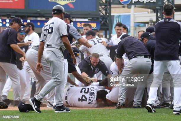 Miguel Cabrera of the Detroit Tigers lays on the ground during a bench clearing fight with the New York Yankees at Comerica Park on August 24 2017 in...