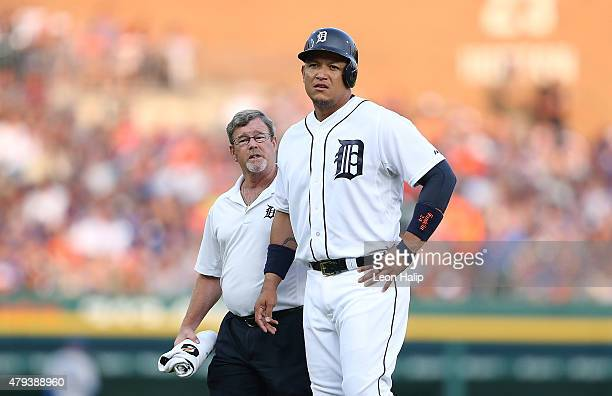 Miguel Cabrera of the Detroit Tigers leaves the game with trainer Kevin Rand during the fourth inning of the game against the Toronto Blue Jays on...