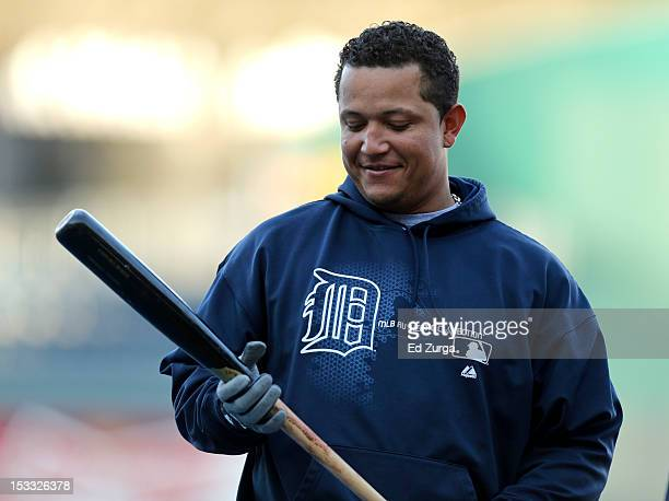Miguel Cabrera of the Detroit Tigers looks down at his bat before taking batting practice prior to a game against the Kansas City Royals at Kauffman...
