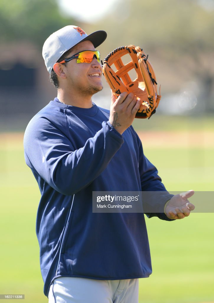 Miguel Cabrera #24 of the Detroit Tigers looks on and smiles during Spring Training workouts at the TigerTown Facility on February 20, 2013 in Lakeland, Florida.