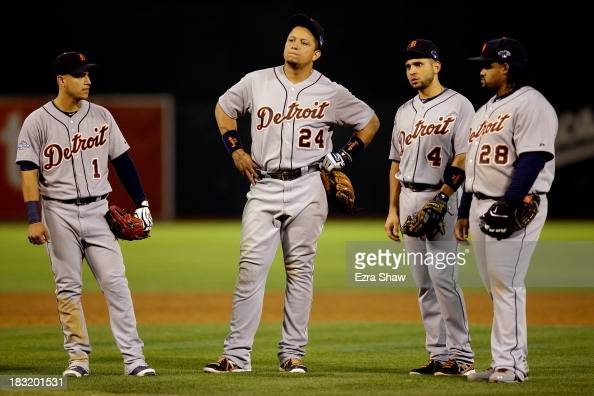Miguel Cabrera of the Detroit Tigers looks on with his teammates during a pitching change in the ninth inning against the Oakland Athletics Game Two...