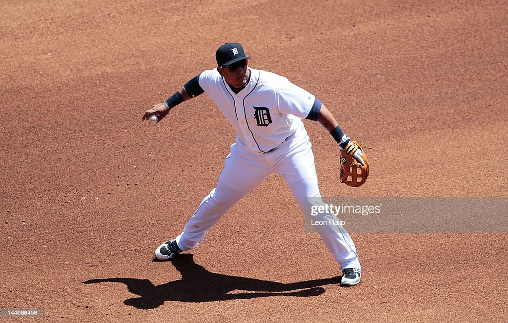 Miguel Cabrera of the Detroit Tigers makes a fielding error on the ground ball from Drew Butera of the Minnesota Twins in the fourth inning during...