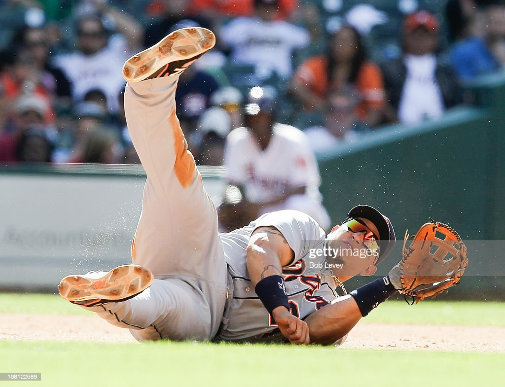 <a gi-track='captionPersonalityLinkClicked' href=/galleries/search?phrase=Miguel+Cabrera&family=editorial&specificpeople=202141 ng-click='$event.stopPropagation()'>Miguel Cabrera</a> #24 of the Detroit Tigers makes a throw from his back to throw out Robbie Grossman #19 of the Houston Astrosin the fifth inning at Minute Maid Park on May 5, 2013 in Houston, Texas.