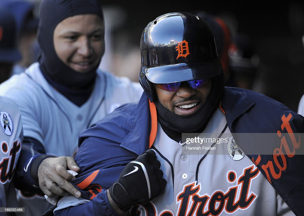 <a gi-track='captionPersonalityLinkClicked' href=/galleries/search?phrase=Miguel+Cabrera&family=editorial&specificpeople=202141 ng-click='$event.stopPropagation()'>Miguel Cabrera</a> #24 of the Detroit Tigers places a coat around <a gi-track='captionPersonalityLinkClicked' href=/galleries/search?phrase=Prince+Fielder&family=editorial&specificpeople=209392 ng-click='$event.stopPropagation()'>Prince Fielder</a> #28 after Fielder scored on a wild pitch during the eighth inning of the Opening Day game against the Minnesota Twins on April 1, 2013 at Target Field in Minneapolis, Minnesota. The Tigers defeated the Twins 4-2.