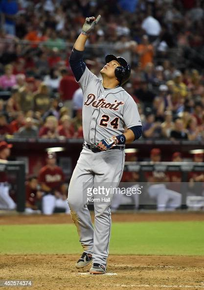 Miguel Cabrera of the Detroit Tigers points to the sky after hitting a threerun home run during the eighth inning against the Arizona Diamondbacks at...