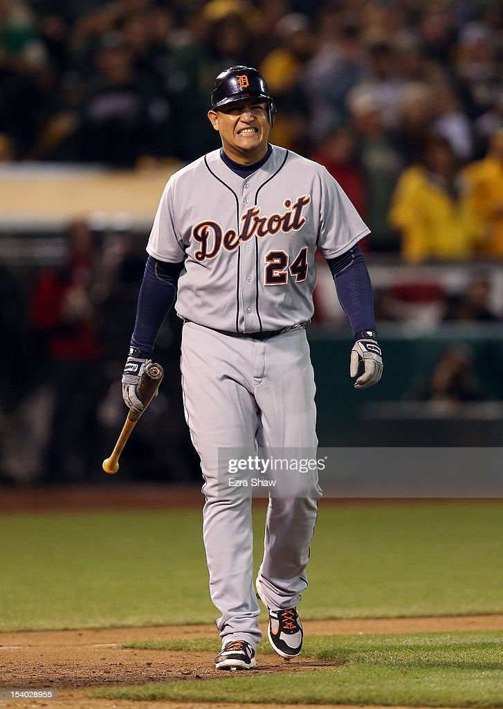 Miguel Cabrera #24 of the Detroit Tigers reacts after he is hit by a pitch in the seventh inning with the bases loaded allowing Omar Infante #4 to score against the Oakland Athletics in Game Five of the American League Division Series at O.co Coliseum on October 11, 2012 in Oakland, California.