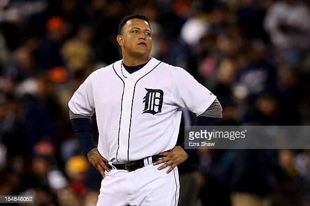 Miguel Cabrera of the Detroit Tigers reacts after hitting a pop up fly ball to Brandon Crawford of the San Francisco Giants against Ryan Vogelsong to...