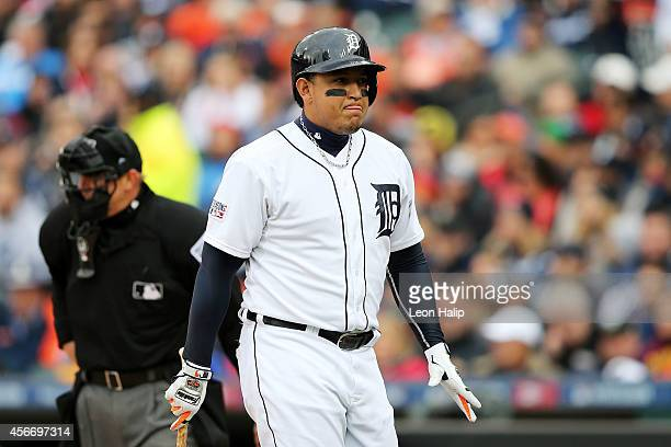Miguel Cabrera of the Detroit Tigers reacts after striking out in the first inning against the Baltimore Orioles during Game Three of the American...