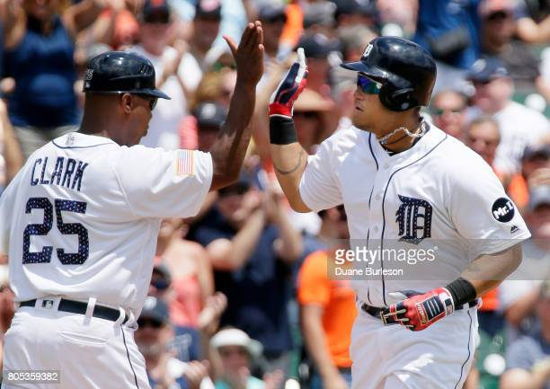 Miguel Cabrera of the Detroit Tigers receives a highfive from third base coach Dave Clark of the Detroit Tigers after hitting a solo home run against...