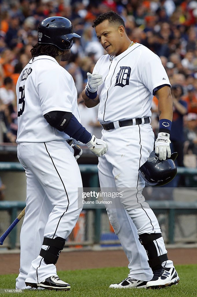 <a gi-track='captionPersonalityLinkClicked' href=/galleries/search?phrase=Miguel+Cabrera&family=editorial&specificpeople=202141 ng-click='$event.stopPropagation()'>Miguel Cabrera</a> #24 of the Detroit Tigers, right, celebrates hit solo home run with <a gi-track='captionPersonalityLinkClicked' href=/galleries/search?phrase=Prince+Fielder&family=editorial&specificpeople=209392 ng-click='$event.stopPropagation()'>Prince Fielder</a> #28 in the first inning of a game against the Philadelphia Philles at Comerica Park on July 27, 2013 in Detroit, Michigan.