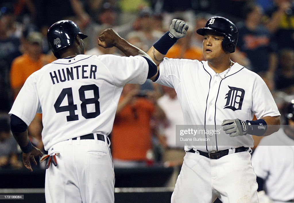 <a gi-track='captionPersonalityLinkClicked' href=/galleries/search?phrase=Miguel+Cabrera&family=editorial&specificpeople=202141 ng-click='$event.stopPropagation()'>Miguel Cabrera</a> #24 of the Detroit Tigers, right, is congratulated by <a gi-track='captionPersonalityLinkClicked' href=/galleries/search?phrase=Torii+Hunter&family=editorial&specificpeople=183408 ng-click='$event.stopPropagation()'>Torii Hunter</a> #48 after hitting a two-run home run that scored the pair against the Chicago White Sox in the eighth inning at Comerica Park on July 9, 2013 in Detroit, Michigan. The White Sox defeated the Tigers 11-4.