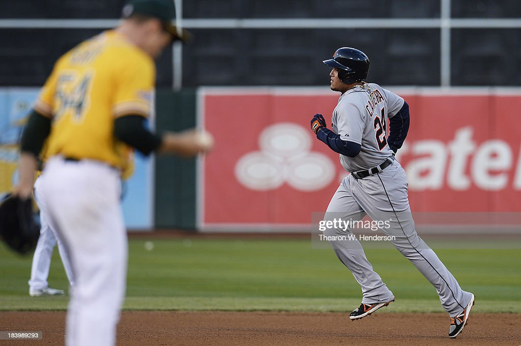 <a gi-track='captionPersonalityLinkClicked' href=/galleries/search?phrase=Miguel+Cabrera&family=editorial&specificpeople=202141 ng-click='$event.stopPropagation()'>Miguel Cabrera</a> #24 of the Detroit Tigers rounds the bases on his fourth inning two-run home run as <a gi-track='captionPersonalityLinkClicked' href=/galleries/search?phrase=Sonny+Gray&family=editorial&specificpeople=8046451 ng-click='$event.stopPropagation()'>Sonny Gray</a> #54 of the Oakland Athletics reacts during Game Five of the American League Division Series at O.co Coliseum on October 10, 2013 in Oakland, California.