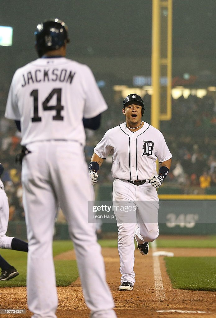 <a gi-track='captionPersonalityLinkClicked' href=/galleries/search?phrase=Miguel+Cabrera&family=editorial&specificpeople=202141 ng-click='$event.stopPropagation()'>Miguel Cabrera</a> #24 of the Detroit Tigers runs home after hitting a three-run home run in the seventh inning scoring <a gi-track='captionPersonalityLinkClicked' href=/galleries/search?phrase=Austin+Jackson&family=editorial&specificpeople=608633 ng-click='$event.stopPropagation()'>Austin Jackson</a> #14 and Torii Hunter #48 during the game against the Atlanta Braves at Comerica Park on April 28, 2013 in Detroit, Michigan. The Tigers defeated the Braves 8-3.