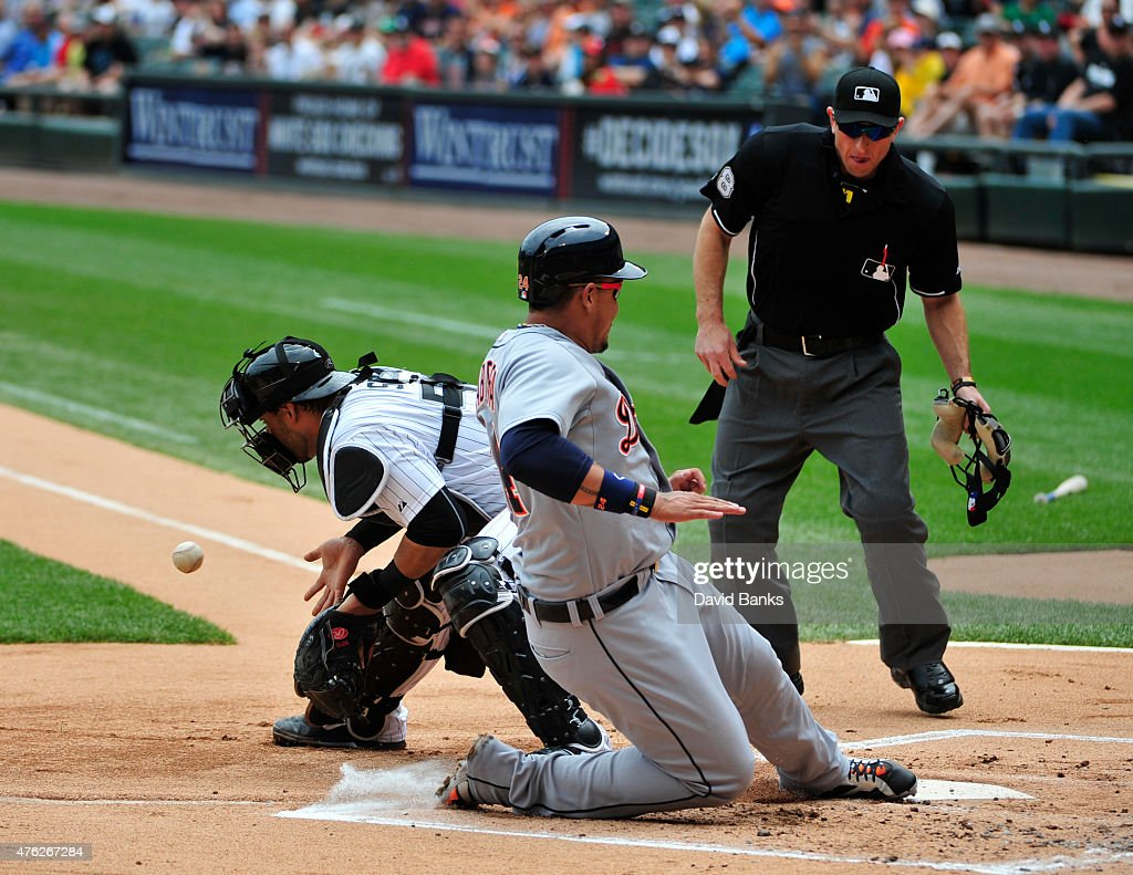 Miguel Cabrera of the Detroit Tigers scores as Geovany Soto of the Chicago White Sox takes the late throw during the first inning on June 7 2015 at...