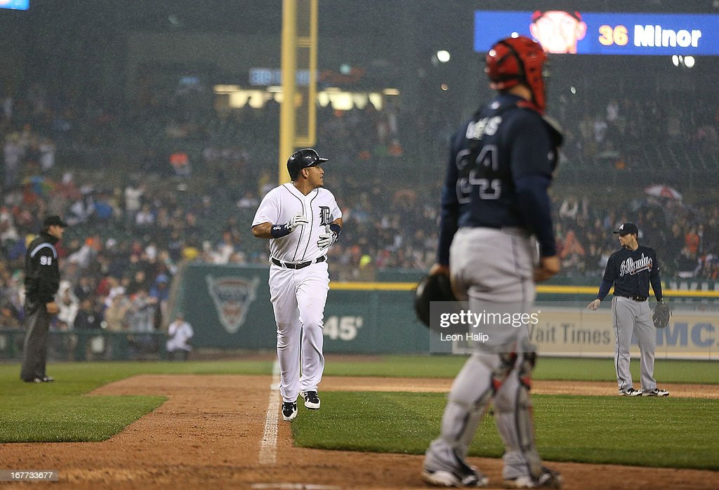 <a gi-track='captionPersonalityLinkClicked' href=/galleries/search?phrase=Miguel+Cabrera&family=editorial&specificpeople=202141 ng-click='$event.stopPropagation()'>Miguel Cabrera</a> #24 of the Detroit Tigers scores on the sacrifice fly by Victor Martinez #41 during the sixth inning of the game against the Atlanta Braves at Comerica Park on April 28, 2013 in Detroit, Michigan.