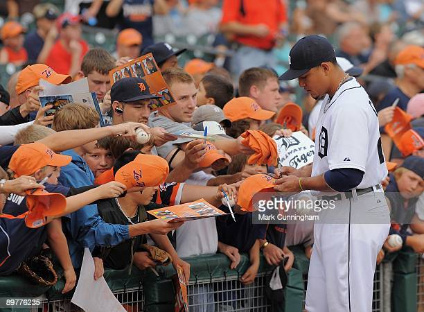 Miguel Cabrera of the Detroit Tigers signs autographs for fans before the game against the Minnesota Twins at Comerica Park on August 8 2009 in...