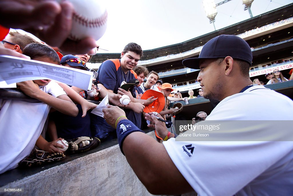 <a gi-track='captionPersonalityLinkClicked' href=/galleries/search?phrase=Miguel+Cabrera&family=editorial&specificpeople=202141 ng-click='$event.stopPropagation()'>Miguel Cabrera</a> #24 of the Detroit Tigers signs for fans before a baseball game against the Cleveland Indians at Comerica Park on June 24, 2016 in Detroit, Michigan.
