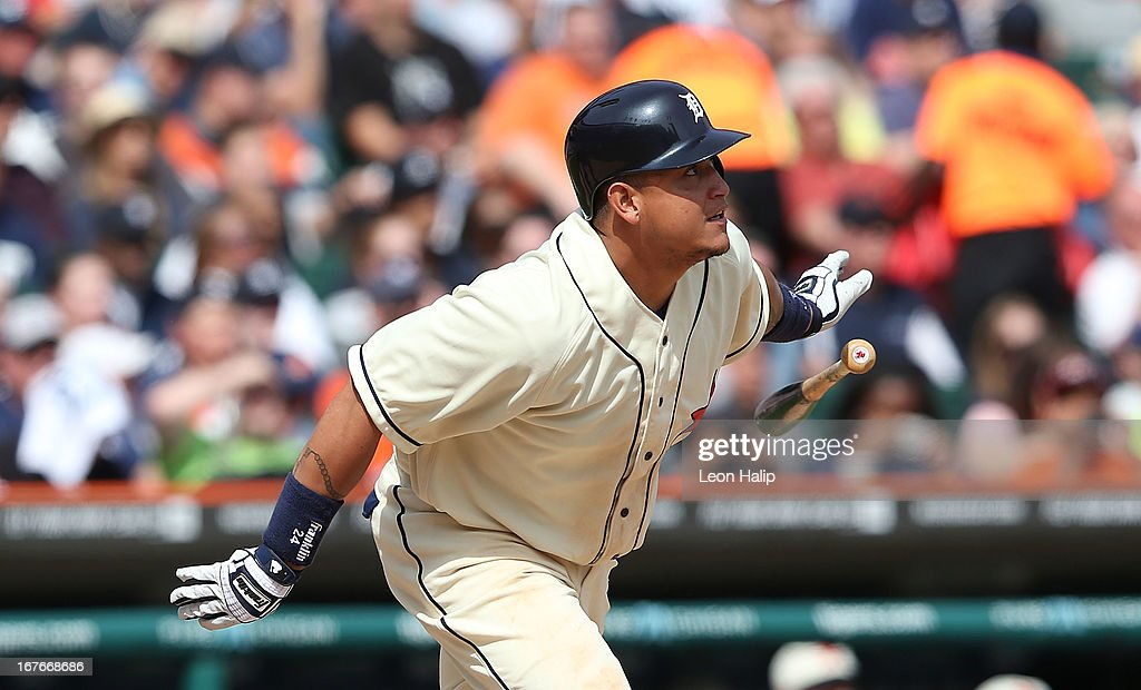 <a gi-track='captionPersonalityLinkClicked' href=/galleries/search?phrase=Miguel+Cabrera&family=editorial&specificpeople=202141 ng-click='$event.stopPropagation()'>Miguel Cabrera</a> #24 of the Detroit Tigers singles to center field during the ninth inning scoring <a gi-track='captionPersonalityLinkClicked' href=/galleries/search?phrase=Omar+Infante&family=editorial&specificpeople=203255 ng-click='$event.stopPropagation()'>Omar Infante</a> #4 during the game against the Atlanta Braves at Comerica Park on April 27, 2013 in Detroit, Michigan. The Tigers defeated the Braves 7-4.